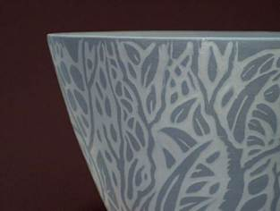 Here i turned the pot in a blue pigment body and added the white porcelain slip in the cutouts.