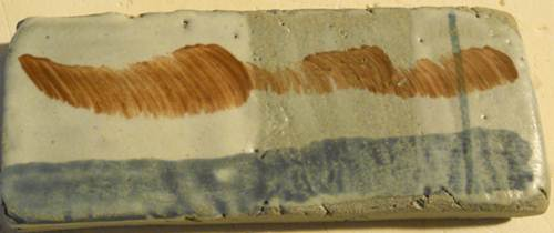 Glaze 25/9/05 satin mat ^6 Name: 25/9/05. This glaze is one that i have used since my academy days.This is a glaze that will make a pot silky to the touch. It gives a durable finish and looks good on porcelain work. You have different see thru efects depending on how thick it is as you see on the test. 47 Feldspar ( Potsah / kali ) + 18 China clay + 22 Whiting ( krijt ) + 4 Zinc oxide + 5 Flint. A good glaze for covering slips or slip trailing.