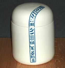 Porcelain slip inlay lidded jar. Turned on kick wheel.