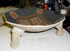 A slab rolled and hump molded work with an ethnic look.