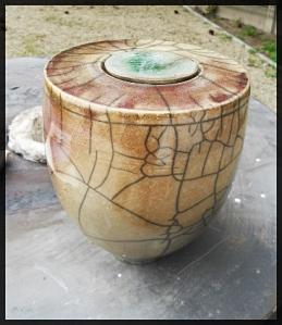 Raku pot with a low temp. copper glaze.