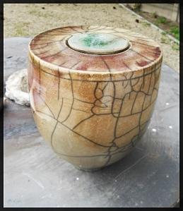 Raku pot with a low temp. copper glaze.