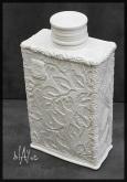 Cone 6 white glaze, ceramic bottle, slab built.