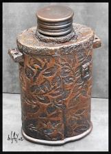 Ceramic bottle, leather look.