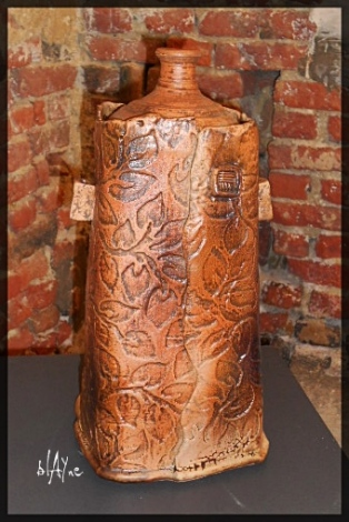 Large ceramic bottle, low temp effects glazes.