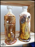 Ceramic bottles , cone 6 white glaze then 1050c low temp, glaze effects added.