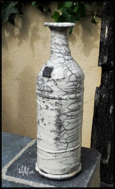 Raku ceramic bottle.