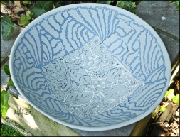 Slip inlay on large bowl shape.