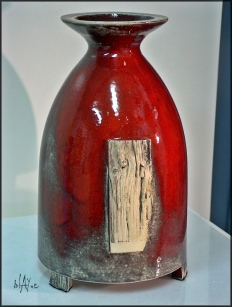 Ceramic bottle shape.