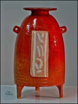 Ceramic bottle, low temp. red glaze.