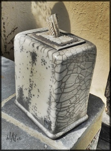 Lidded container, slab built , raku clay.