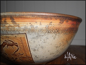 A close up of the side of the wood fired bowl.