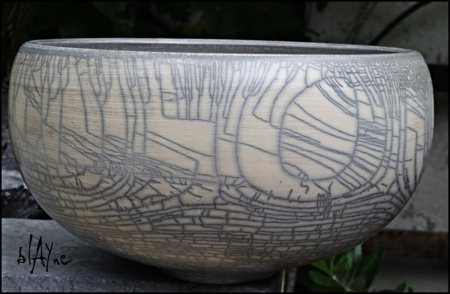 Terra raku pot side view.