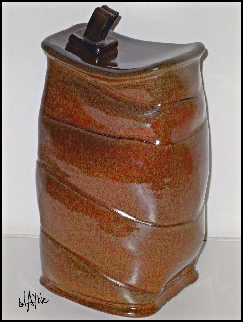 Cone six iron red, oxidation glaze.