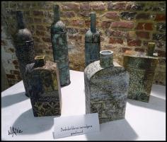 Exhibition table showing different ceramic techniques.