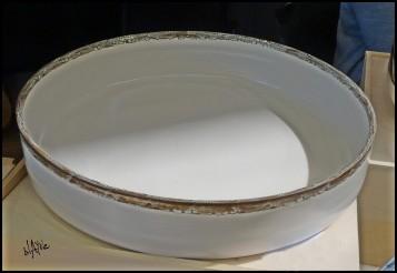 Large white platter with a crawl glaze on edge.
