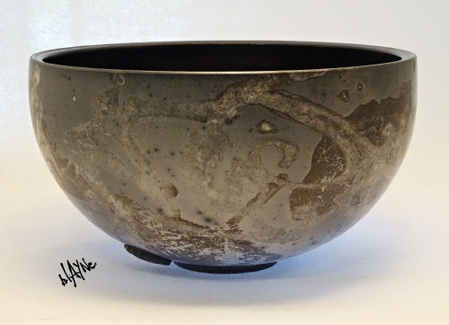 This pot has 3 types of terra on it and was smoke fired.