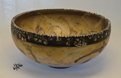 A yellow clay terra sigillata with darker terra patterns.