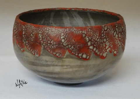 White crawl on a underglaze background. Two types of terra .Saggar fire.