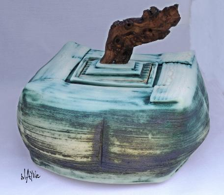 Porcelain box. Wood handle.