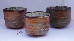 Ceramic tea bowls. Turned on kickwheel and shaped.