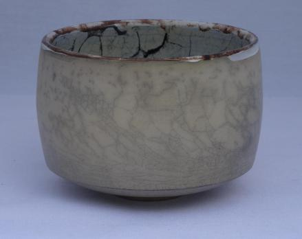 Tea bowl glazed inside , Terra Sigillata outside.