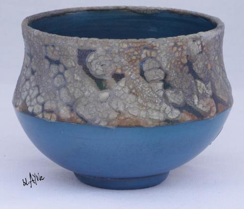 Blue terra and crawl glaze.