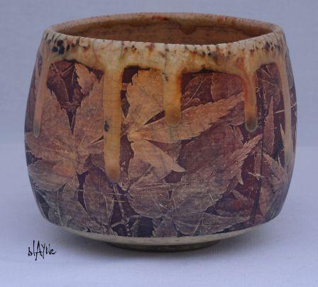 Ceramic Tea bowl with lazer decal and crawl glaze.