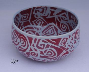 Porcelain bowl with clear glaze.