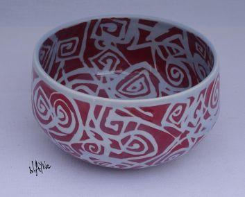 Porcelain bowl with clear glaze.