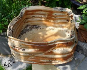 Large square shape , turned on kick wheel and reshaped. Terra sigillata and crawl glazes.