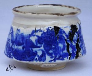 Blue print on porcelain slip, torn clay.