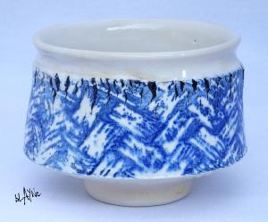 Blue print on Porcelain slip. With torn clay decoration.
