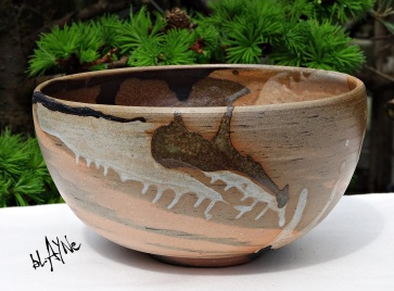 Porcelain slips on stoneware, woodfire cone 6 Stain in clay
