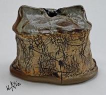 Porcelain slips on stoneware, woodfire cone 6