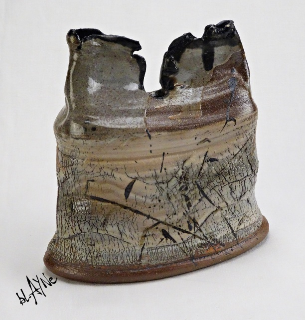 Porcelain slips on stoneware, woodfire cone 6