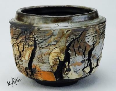 Porcelain slips on black clay, wood fire 1230c