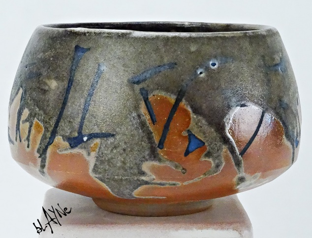 Slip inlay, shino glaze with a lot of carbon trap from wood fire 1230c
