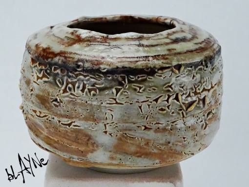 stoneware clay, Shino glaze with carbon trap.