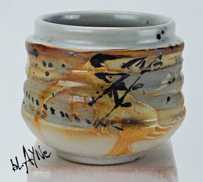 Stoneware clay with two different pigments mixed in. Shino glaze, wood fire 1230c.