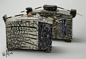 Pair of ceramic boxes. black clay and porcelain slip.
