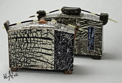Pair of ceramic boxes. black clay and porcelain slip.