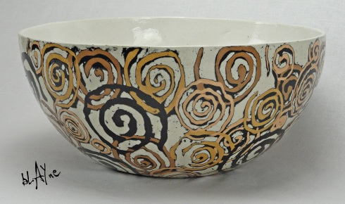 Large bowl shape made in a mold decorated with porcelain slips.