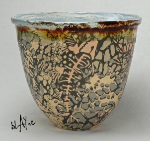 Stone ware paper clay pot formed in a mold with stoneware slip decoration.