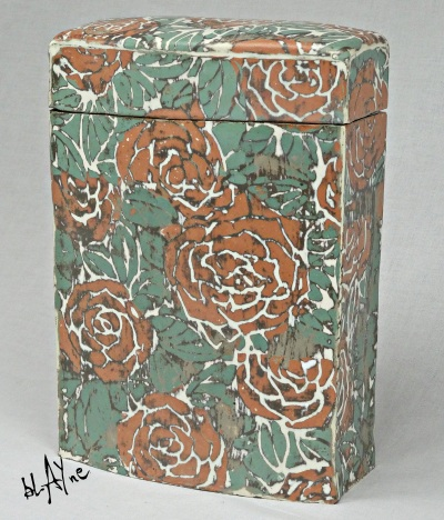 Ceramic box that was slab built with slip decorated slabs. Slabs decorated before building.