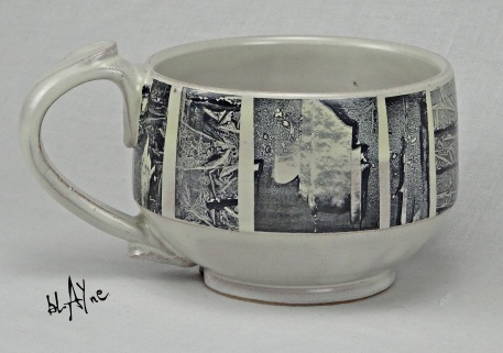 Red clay and white glaze with ceramic ink on water slide paper decoration. Just black pigments with a small amount of glass agent.