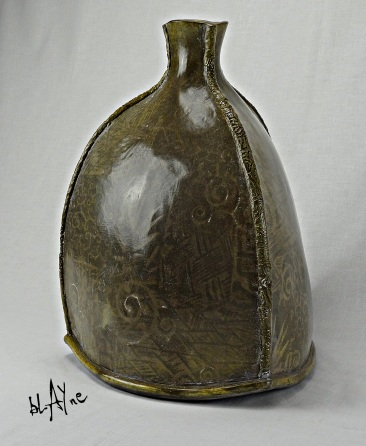 Ceramic bottle, slab built with inlayed slip slabs.
